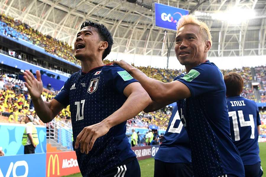 先制ゴールを決めた香川と長友【写真:Getty Images】
