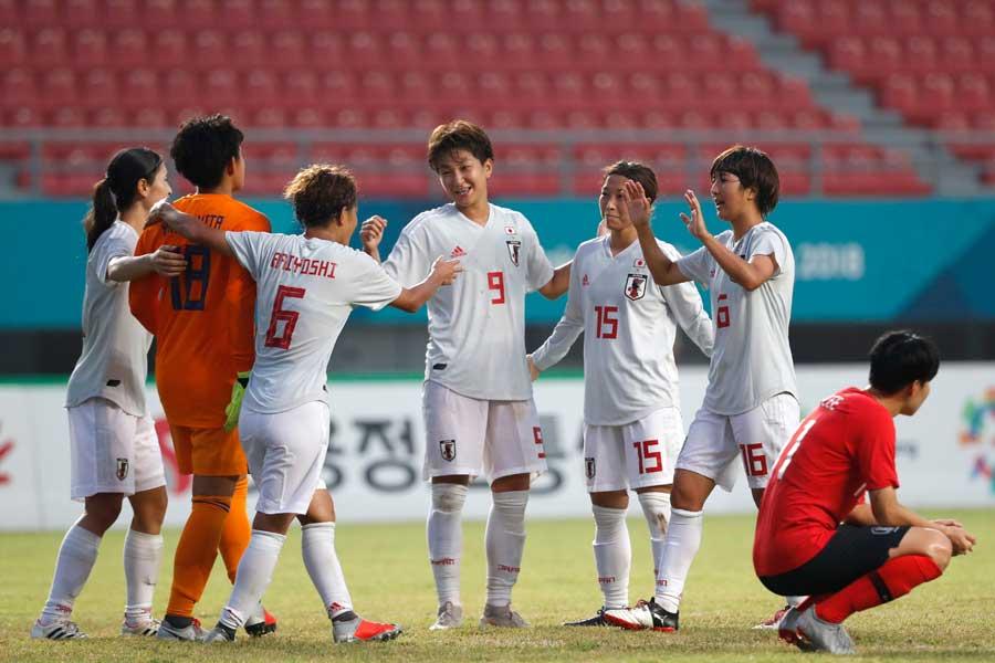 サッカー女子は準決勝で韓国を2-1で破り、決勝進出を果たした【写真:AP】