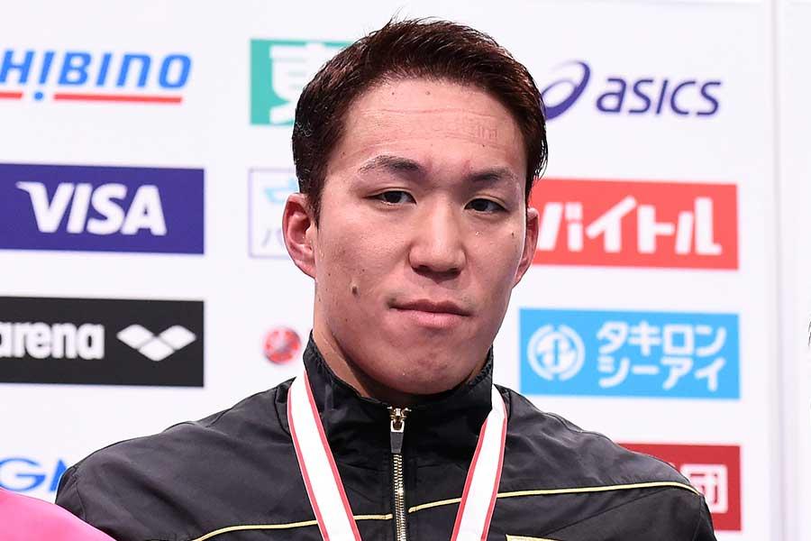 男子100メートル平泳ぎに出場する小関也朱篤【写真:Getty Images】