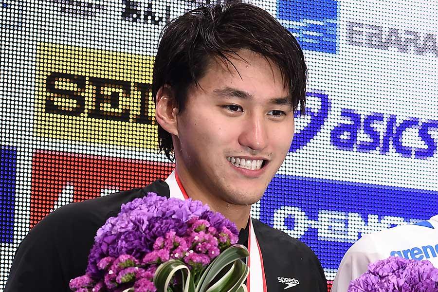 男子200メートル背泳ぎに出場する砂間敬太【写真:Getty Images】