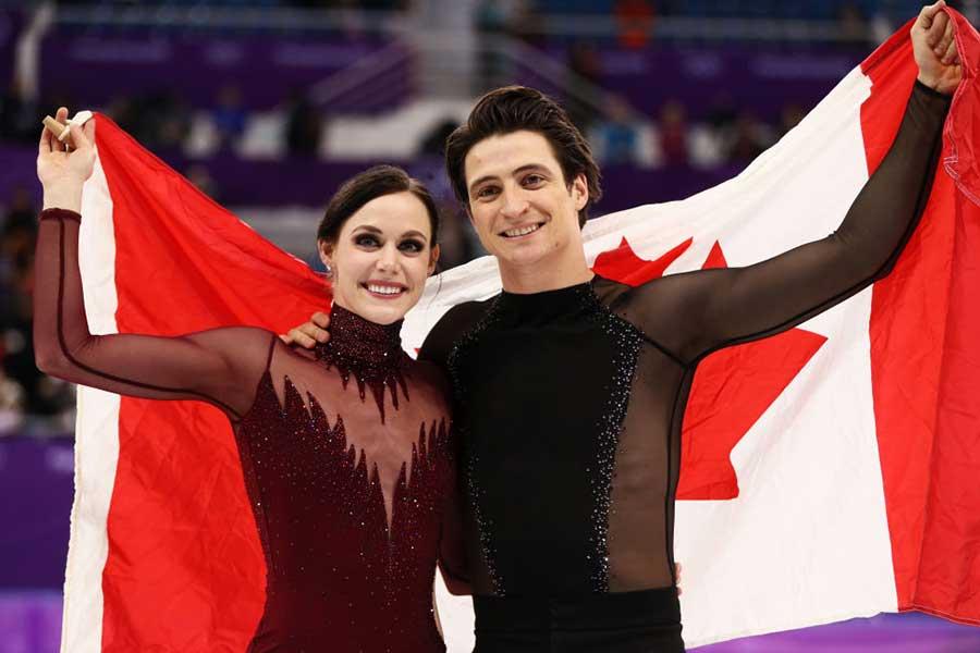 テッサ・ヴァーチュ(左)とスコット・モイア【写真:Getty Images】