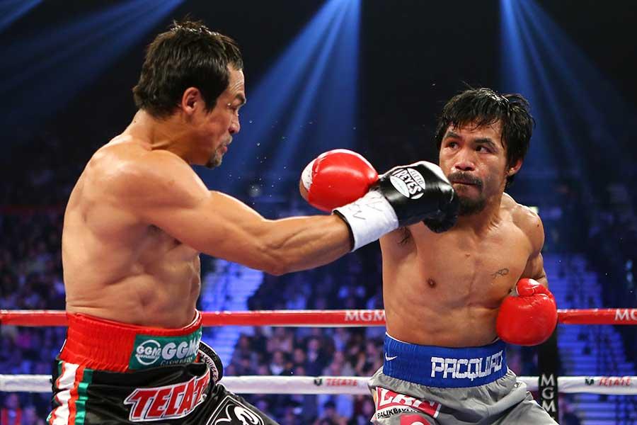 2012年12月、マニー・パッキャオ(右)はフアン・マヌエル・マルケスにKO負けした【写真:Getty Images】